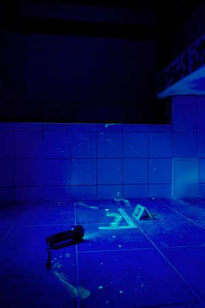 theft proof: Bathroom - place of crime under UV light Stock Photo