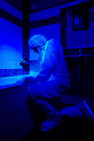 the fbi: Technician at work on place of crime Stock Photo