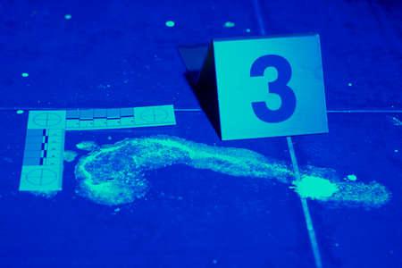 the fbi: Footprint evidence on place of bloody crime under UV light Stock Photo
