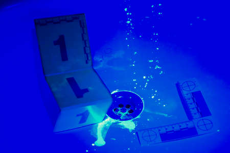 developing: Developing of evidence on place of bloody crime with UV light
