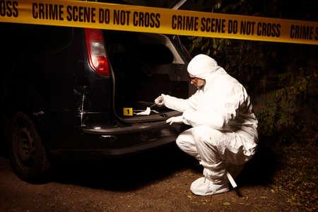 criminology: Crime scene investigation - collecting of odor traces by criminologist