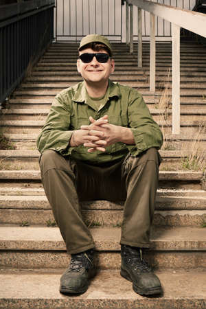 Soldier on sentry duty smiling on stairs Stock Photo