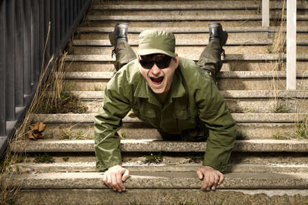 Soldier on sentry duty making fun on stairs Stock Photo