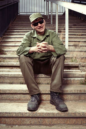 Soldier on sentry duty sitting on stairs