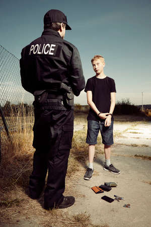 pickpocket: Police man catching teenage pickpocket outdoor Stock Photo