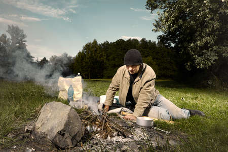 outdoor fireplace: Vagabond young man sleeping in park checked by police patrol