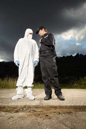 Police man with criminologist technician