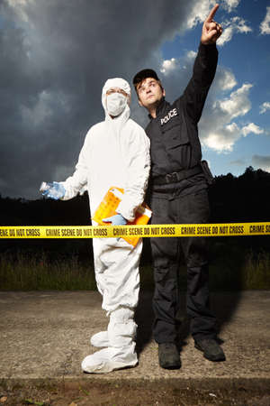Police man communicating with criminologist technician Stock Photo