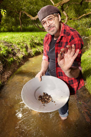 when: Contemporary lucky prospector found lot of gold in creek when panning sand