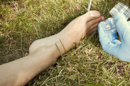 Collecting of fly larva around victim's body