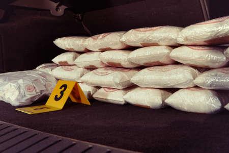Criminal drug dealer found mordered in car under bridge with trunk full of drugs