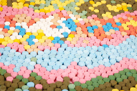 Selection of pills of MDMA (Extasy) distributed by drug dealer seized by legal authority Stock Photo