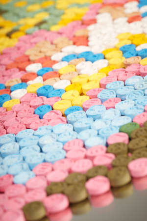 Detail of pills of MDMA (Extasy) distributed by drug dealer seized by legal authority Stock Photo