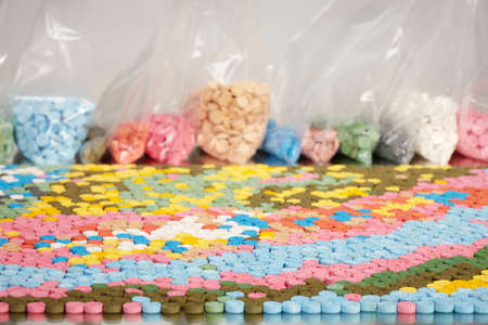 Various colors of pills of MDMA (Extasy) distributed by a drug dealer seized by a legal authority