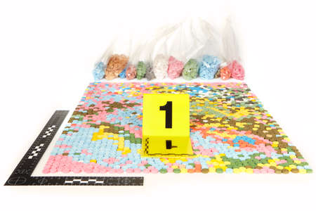 Seized pills of extasy contraband found by legal authorities Stock Photo