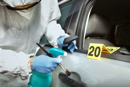 Crime scene investigation - developing of latent fingerprint on car