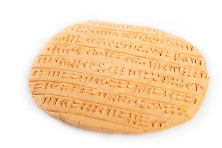 Ancient type of Akkad empire style cuneiform writing in brown clay