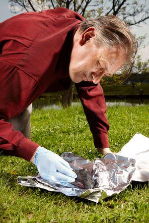 Happy man found falling meteorite on spring meadow