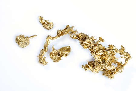 Gold pieces and nuggets found by amateur prospector isolated on background