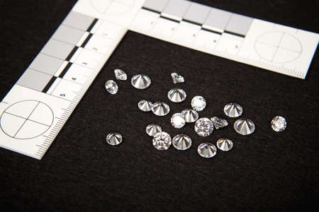 Seized contraband of smuggled diamonds documented by police authority with metric scale