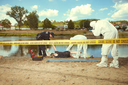 Woman body in black apparel found drowned near summer river bank in city