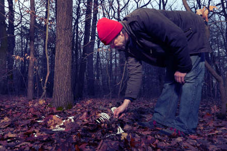 Couple of father and son found human skeleton when walking in winter forest