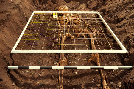 Exploring of ancient grave on outdoor field location Stock Photo