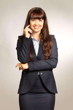 Pretty brunette lady posing for portrait in studio Stock Photo