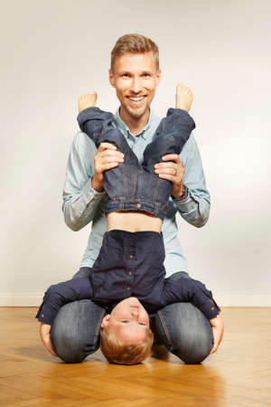 Young cute father with three years old son Stock Photo