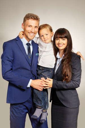 Young cute married couple with three years old son