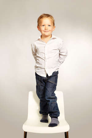 Cute young  three years old boy posing in studio Stock Photo