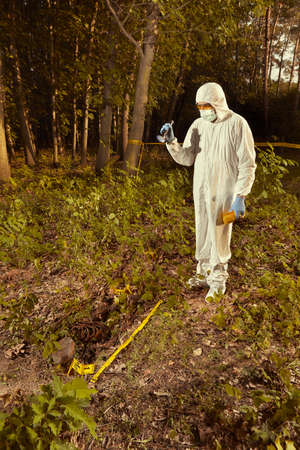 Older human remains found in forest - collecting of skeleton by police Banco de Imagens