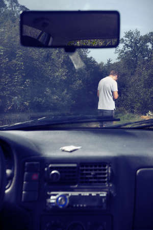 Addicted criminal stalking lonely man on city forest way Reklamní fotografie