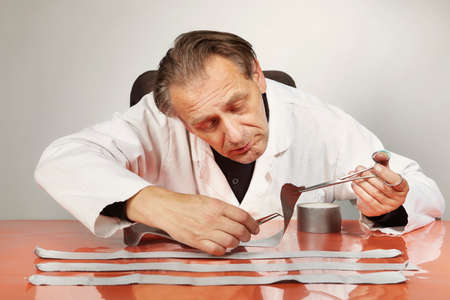 Exploring of evidence - tape used for bondage of victim