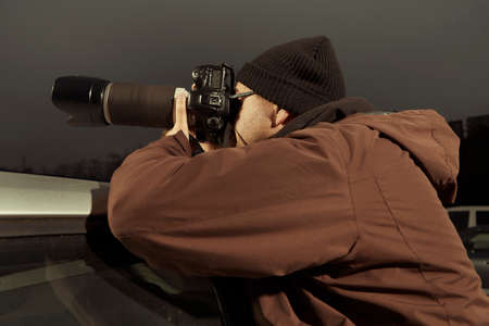 Paparazzi journalist waiting in the evening time for person to catch Stok Fotoğraf
