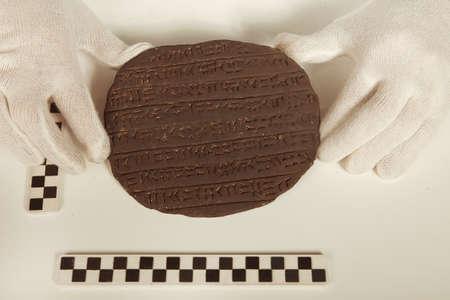Scientist in museum office working on cuneiform find