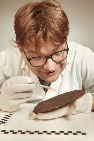 Scientist in museum office working on cuneiform find