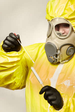 Specialist in virus protective suit getting mucous membrane smear for testing Stock Photo