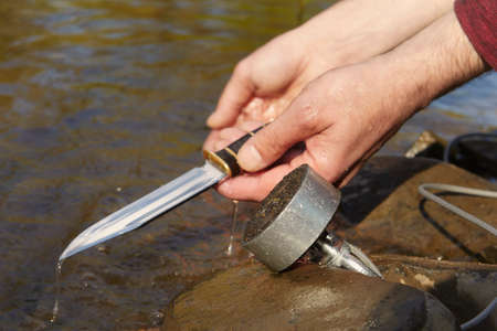 Man found hunting knife in river water by magnet