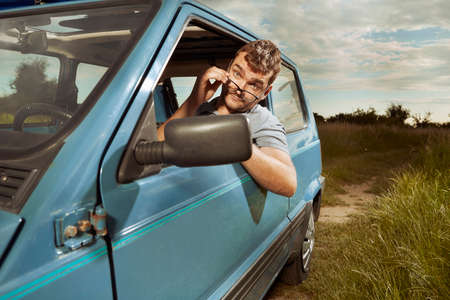 Man on summer trip with his lovely small retro car Stok Fotoğraf
