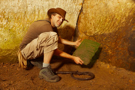 Adventurer in ancient cave finally found mysterious artifact emerald tablet