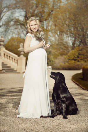 Two pregnant beauties - woman and female dog Foto de archivo