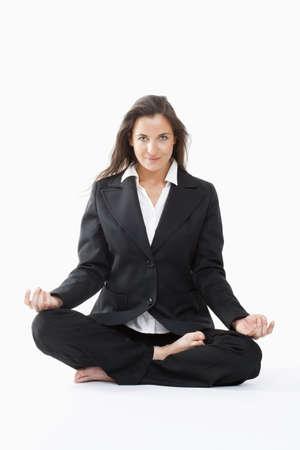 beautiful businesswoman in black suit exercising yoga  photo