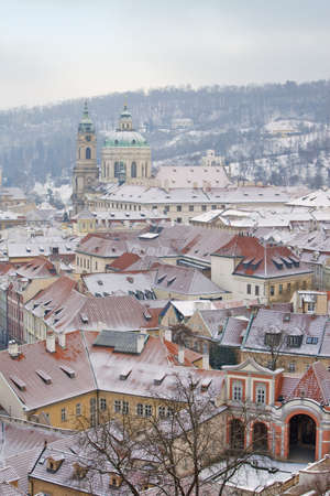lesser: prague - winter view of lesser town rooftops covered with snow