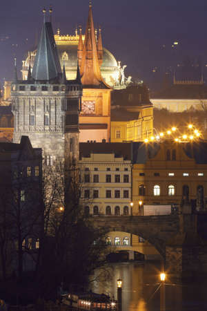 czech republic, prague - towers of the old town and national theatre at dusk