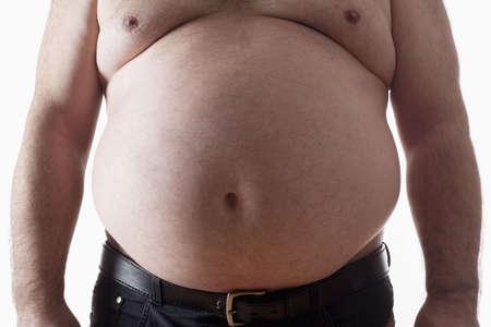 obeso: gran vientre de un hombre gordo aislado en blanco Foto de archivo