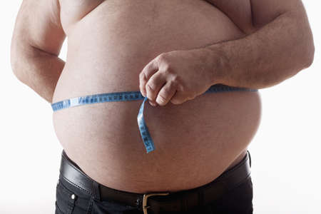 large size: big belly of a fat man and measuring tape isolated on white Stock Photo