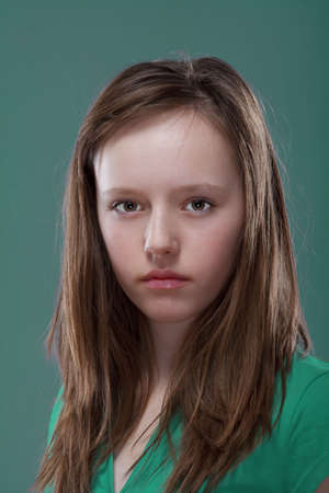 studio portrait of a pretty, eleven years old girl photo