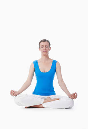 woman exercising hatha yoga - isolated on white