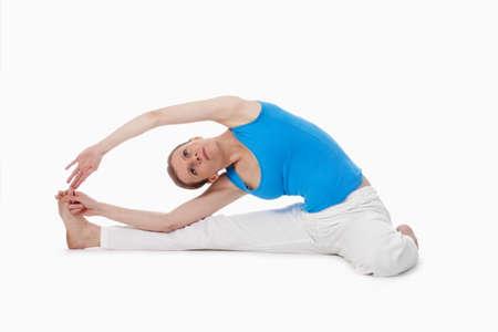 hatha: woman exercising hatha yoga - isolated on white